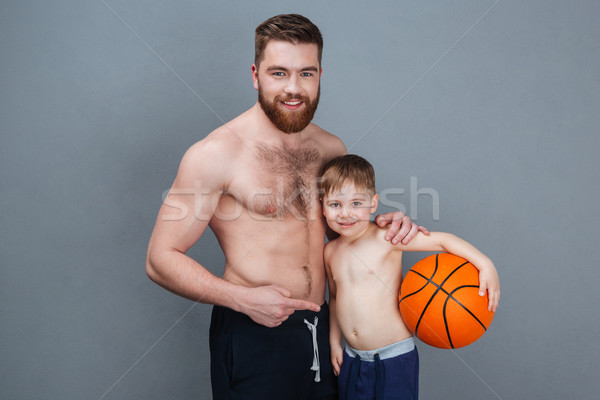 Happy shirtless dad and son holding basketball ball  Stock photo © deandrobot