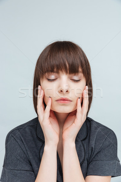 Beautiful portrait of a relaxed woman with closed eyes Stock photo © deandrobot
