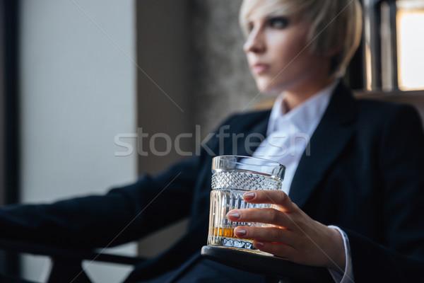 Elegáns szőke nő lány ül kávézó üveg Stock fotó © deandrobot