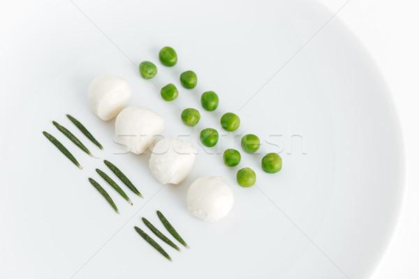 Gyógynövények zöld zöldborsó mozzarella tányér fehér Stock fotó © deandrobot