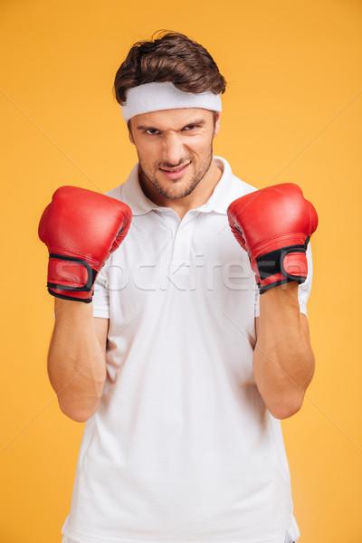 Retrato forte moço boxeador vermelho luvas Foto stock © deandrobot