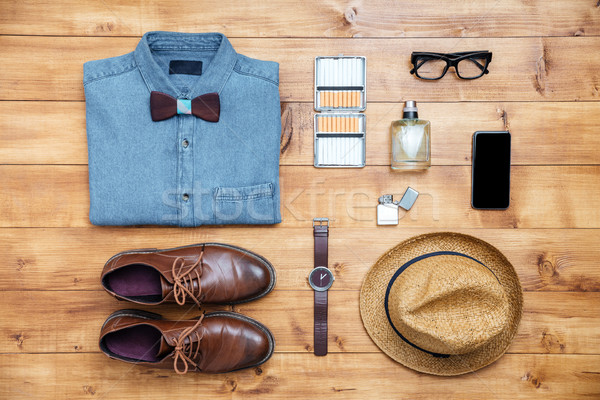 Travel concept shoes, shirt, mobile phone, watch, parfume, eyegl Stock photo © deandrobot