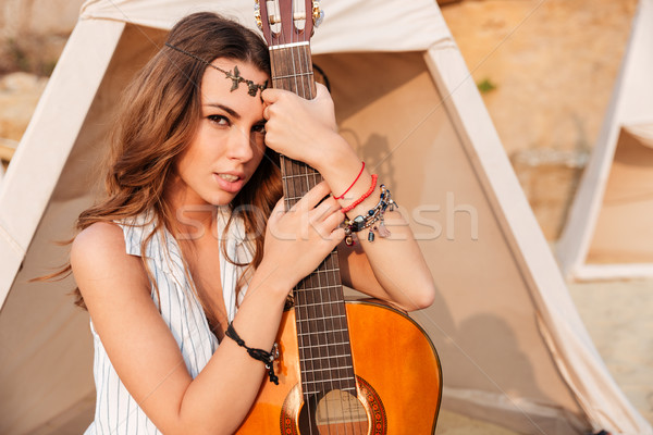 Close up portrait of a beautiful hippie girl with guitar Stock photo © deandrobot