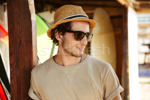 Close up portrait of a man in sunglasses and hat Stock photo © deandrobot