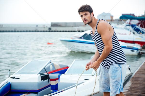 élégant jeunes marin corde pier Photo stock © deandrobot