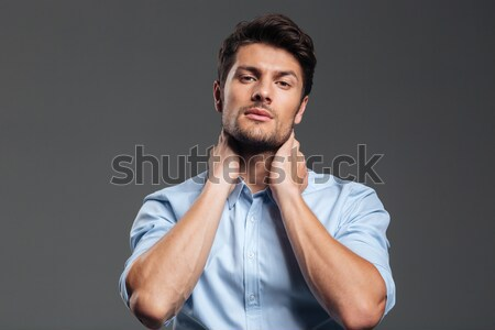 Businessman with eyes closed having neck pain Stock photo © deandrobot