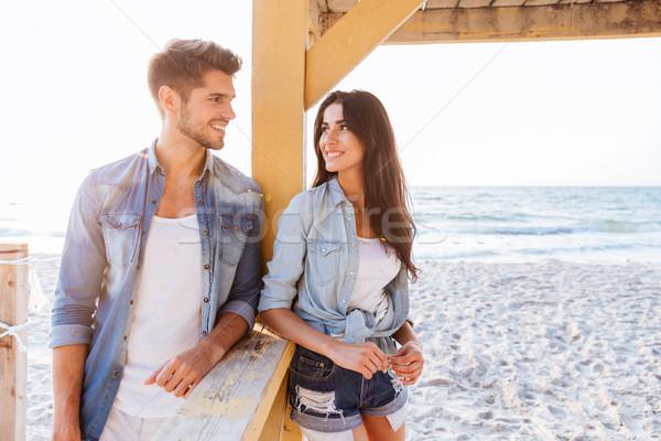 Jovem alegre casal praia belo Foto stock © deandrobot