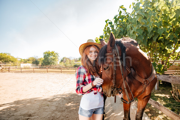 笑顔の女性 徒歩 馬 村 笑みを浮かべて かわいい ストックフォト © deandrobot