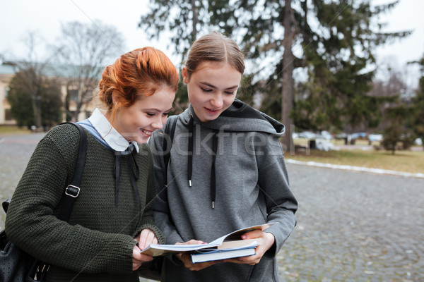 Two teenage female students with book outside Stock photo © deandrobot