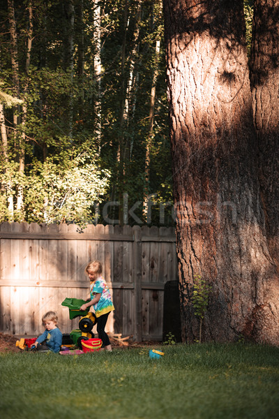 Full length image of boy and girl on playground Stock photo © deandrobot