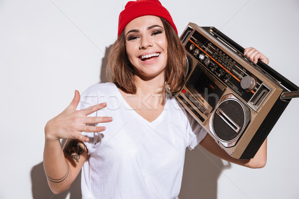 Young happy woman holding tape recorder. Stock photo © deandrobot