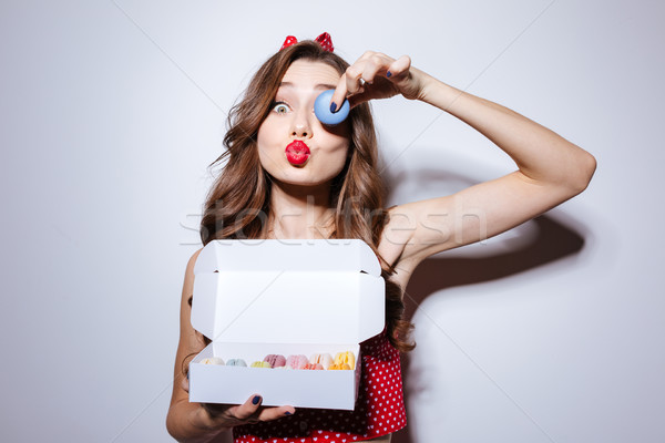 Funny girl with confection Stock photo © deandrobot