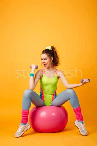 Mutlu genç fitness woman poz sarı görüntü Stok fotoğraf © deandrobot