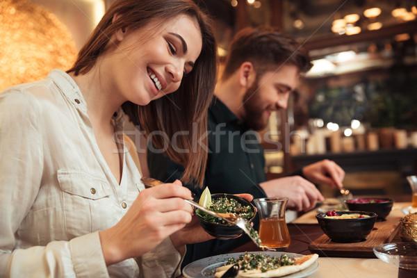 привлекательный молодые любящий пару сидят кафе Сток-фото © deandrobot