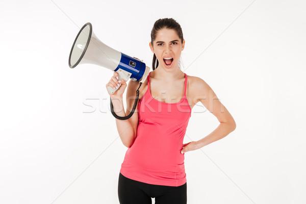 Jovem mulher grávida megafone olhando câmera Foto stock © deandrobot