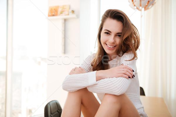 Ritratto maglione seduta home sorridere Foto d'archivio © deandrobot