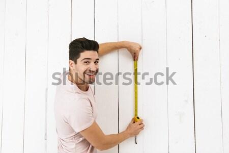 Portrait of man with measure tape Stock photo © deandrobot