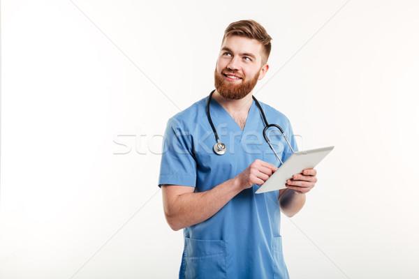 Portret jonge peinzend medische arts verpleegkundige Stockfoto © deandrobot