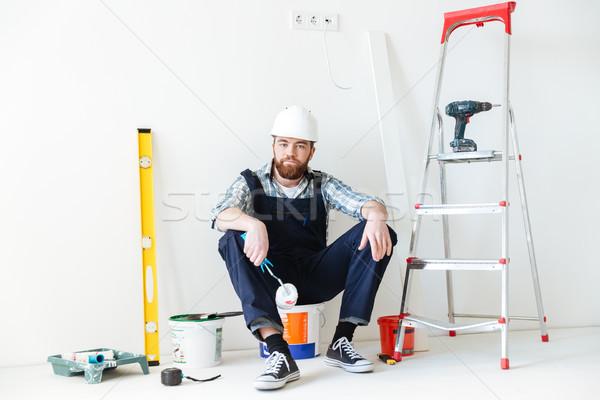 Stock photo: Upset man making repair in house