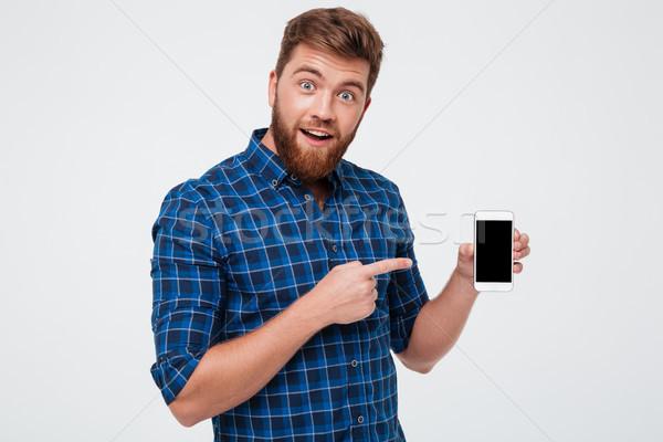 étonné barbu homme à carreaux shirt Photo stock © deandrobot