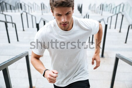 Close up of a healthy male runner in sport clothes Stock photo © deandrobot