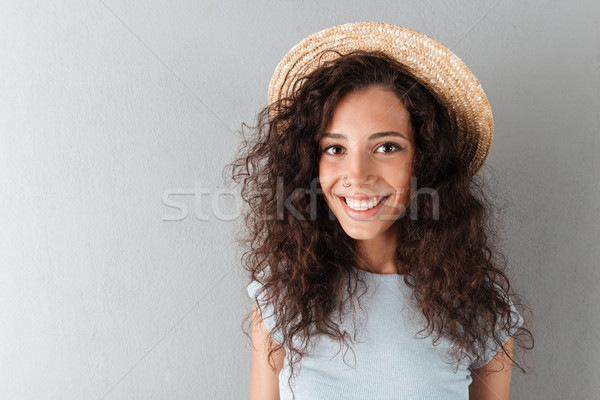 Close up picture of Happy curly woman in hat Stock photo © deandrobot