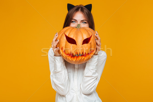 Happy young woman dressed in crazy cat halloween costume Stock photo © deandrobot