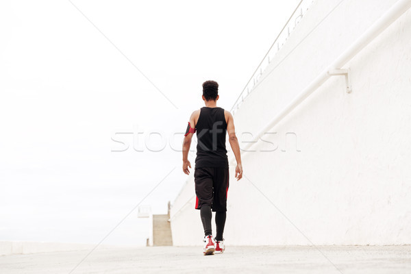 Back view image of young african sports man Stock photo © deandrobot