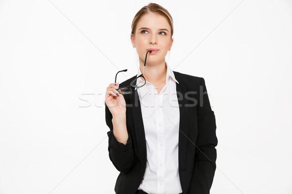 Sinsi dalgın iş kadını gözlük Stok fotoğraf © deandrobot