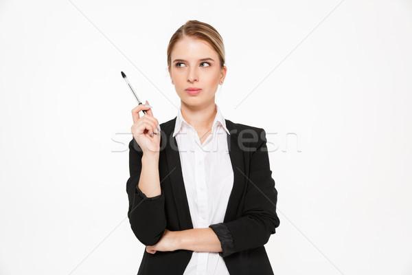 Peinzend blond zakenvrouw pen Stockfoto © deandrobot
