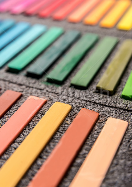 Close-up photo of new colorful chalk pastels in box Stock photo © deandrobot