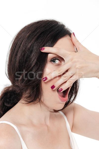 Közelkép portré nő arc kéz meglepődött Stock fotó © deandrobot