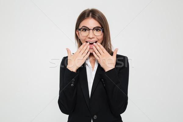 Portré izgatott üzletasszony öltöny szemüveg száj Stock fotó © deandrobot