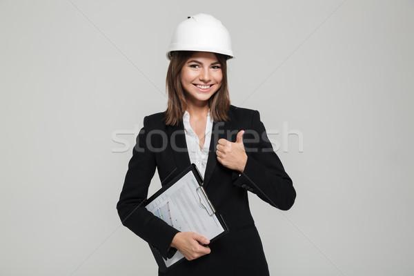 肖像 満足した 笑顔の女性 ヘルメット スーツ ストックフォト © deandrobot