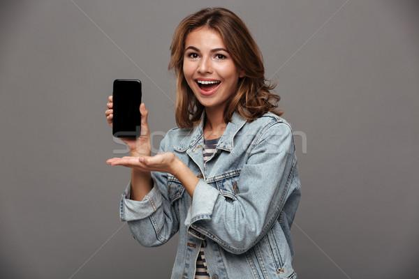 Portret mooie tienermeisje denim jas vrolijk Stockfoto © deandrobot