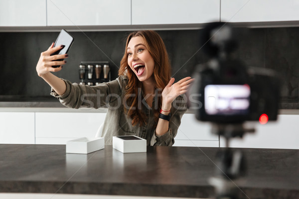 Happy young girl recording video blog episode Stock photo © deandrobot