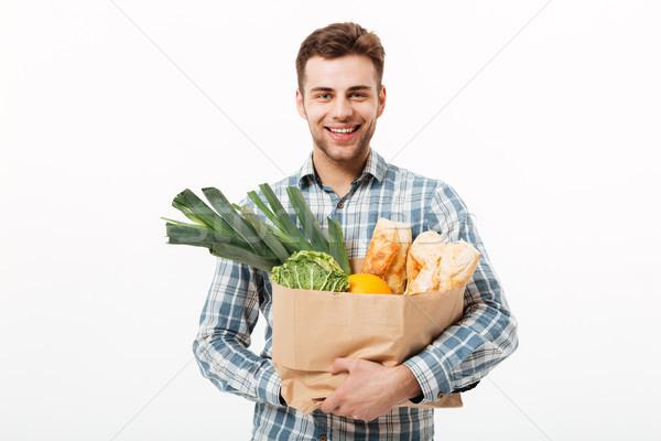 Portret uśmiechnięty człowiek torby papierowe pełny Zdjęcia stock © deandrobot