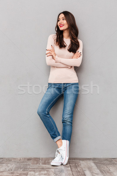 Full-length portrait of young woman with red lips makeup standin Stock photo © deandrobot