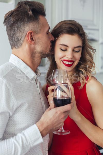 Portrait of a happy romantic smart dressed couple Stock photo © deandrobot