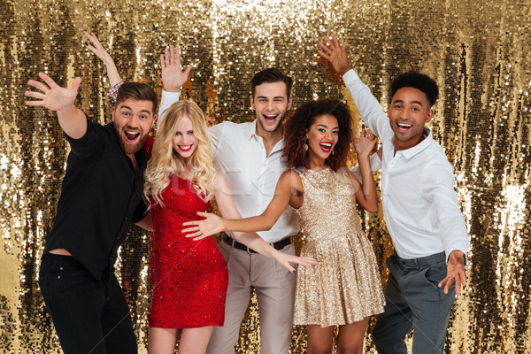 Group of happy friends celebrating new year Stock photo © deandrobot