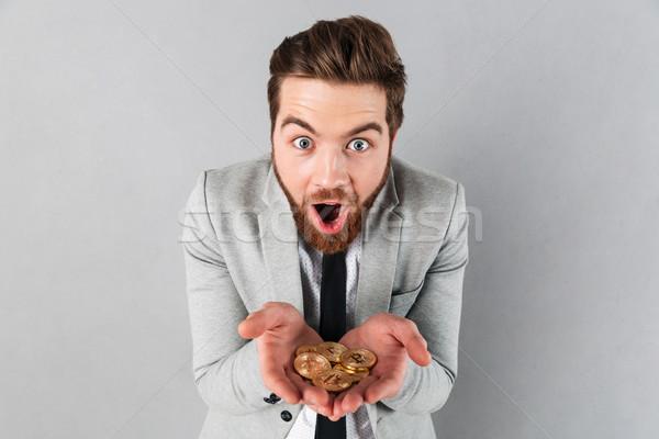 Retrato satisfeito empresário dourado mãos Foto stock © deandrobot