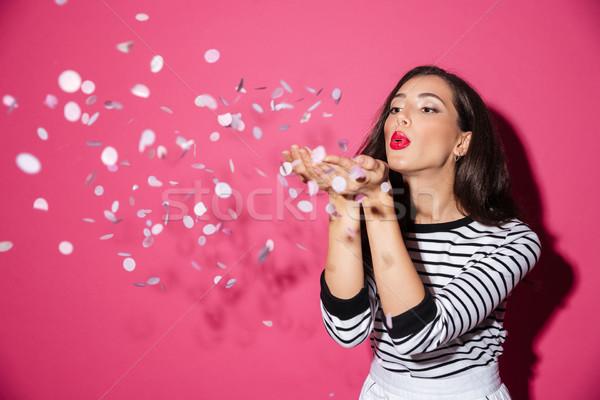 Portret mooie vrouw confetti handen geïsoleerd Stockfoto © deandrobot