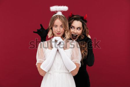 Full length portrait of two excited smiling women Stock photo © deandrobot