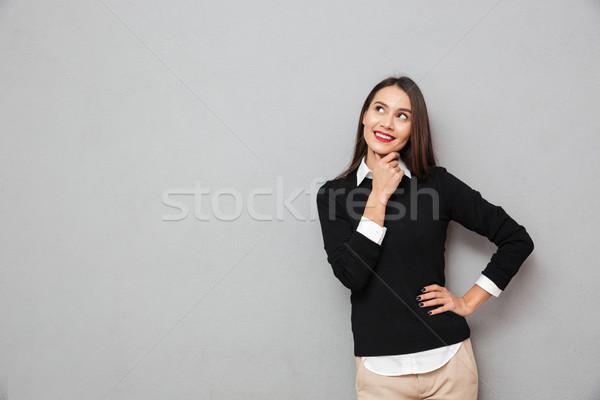 Dalgın gülümseyen kadın iş elbise kol kalça Stok fotoğraf © deandrobot