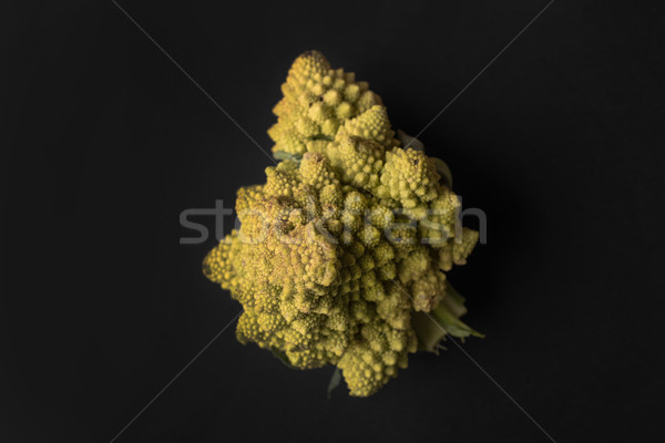 Close up of a ripe cauliflower isolated over black Stock photo © deandrobot