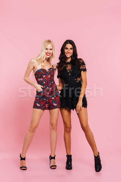 Happy party ladies standing and smiling isolated Stock photo © deandrobot