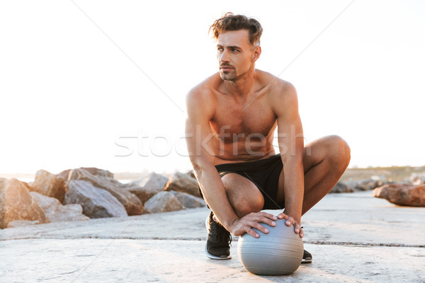 Portrait of a handsome shirtless sportsman Stock photo © deandrobot