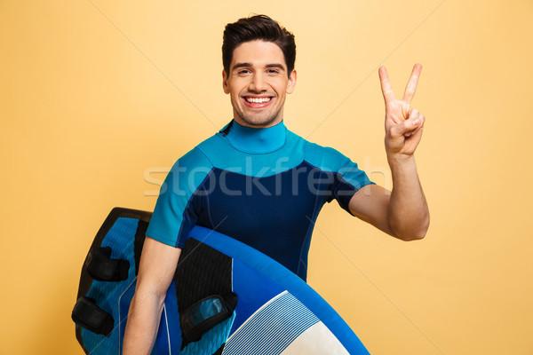 Retrato sonriendo joven traje de baño paz Foto stock © deandrobot