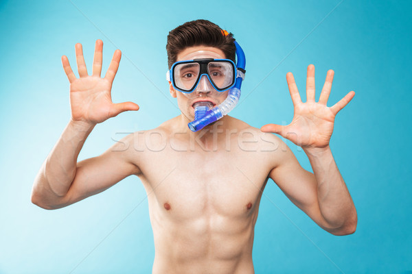 Portrait of a cheerful young shirtless man in swim goggles Stock photo © deandrobot