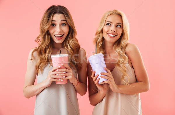 Stock photo: Two happy pretty women in dresses posing together